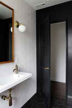 All white herringbone tile and black door / minimal modern bathroom design White Bathroom Tiles, Bathroom Renos, White Tiles, Small Bathroom, Gold Bathroom, Black Bathrooms, Wall Tiles, Hex Tile, Black Bathroom Floor