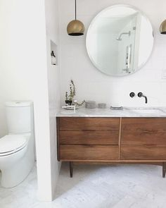 "This is still one of my favorite bathroom renovations that I've gotten to be apart of. This mid-century ""dresser turned vanity"" has been… Boho Bathroom, Bathroom Interior, Small Bathroom, Master Bathroom, Yellow Bathrooms, Chic Bathrooms, Dresser Vanity Bathroom, Bathroom Vanities, Mid Century Dresser"