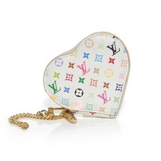 This is an authentic LOUIS VUITTON Multicolor Coeur Heart Coin Purse in White. This stylish coin purse is constructed of Multicolore Louis Vuitton mini monogram on durable white toile canvas in the shape of a heart.