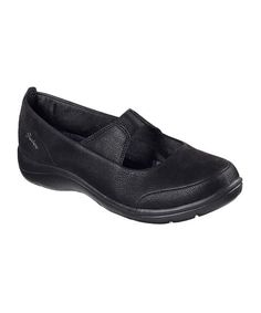 An elastic strap offers this effortless slip-on a snug fit and sweet mary jane-inspired silhouette, while its padded collar and cushioned footbed ensure cushioned comfort. At just 4 oz., its light construction keeps you from feeling weighed down. 1'' heelSlip-on / elastic strapPadded collarAir Cooled Memory Foam™ cushioned comfort footbedSuper lightweight shock-absorbing flexible midsoleMan-made upperTextile liningFlexible traction man-made soleImported