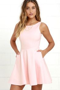 There's nothing more luxurious than a bottle of bubbly and the NBD Pink Champagne Coral Pink Skater Dress! Woven poly shapes a triangle bodice with cutout detail bedecked with shiny faux pearls. Seamed skater skirt flares to a perfect flirty finish. Adjustable straps. Hidden back zipper/hook clasp.