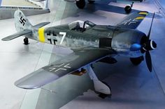 "Harold A. Skaarup, author of Shelldrake Focke-Wulf Fw 190F-8/R1 (Wk Nr. 931884), initially coded ""Yellow 10"" from I./SG2. This aircraft was shipped to the USA and designated FE-117. It is restored and currently painted as ""White 7"", on display in the Steven F. Udvar-Hazy Center, Chantilly, Virginia. (Kogo Photo)"