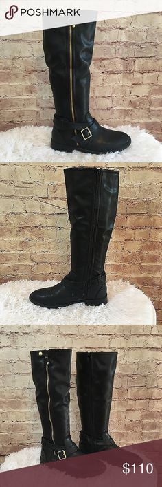 """Dolce Vita Black Leather Riding Boots (NWOT) NWOT Black leather riding boots with gold buckle detail. The boots have a gold exposed zipper with snap on the outside of the boot, a strap with gold buckle around the ankle and inside full zipper. Size 8 1/2. Heel 1"""". Shaft height 16"""". Shaft circumference 14.5"""". Dolce Vita Shoes"""