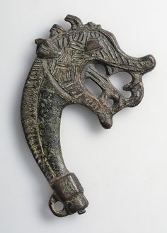 "Viking pin-head made of bronze haped as a dragon´s head. Dress-pins of this kind were usually gilded with silver or gold. Gotland, Sweden. Object from the exhibition ""We call them Vikings"" produced by The Swedish History Museum"