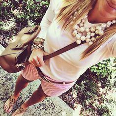 love the pearls on white shirt with colored shorts. perfect early summer look.