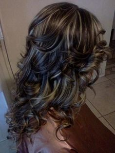Love this color - dark curls and blonde lowlights.
