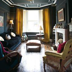 dark living room with mustard curtains