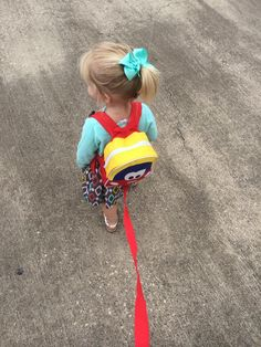 """From a Facebook fan, """"Berklee loves her cozy coupe harness backpack"""""""