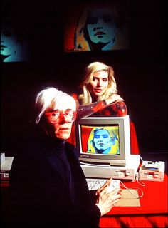 "Andy Warhol ""paints"" Deborah Harry using  a programme on an Amiga computer at the product's launch press conference in 1985."