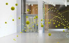 Spanish visual artist Ana Soler created a object named Causa-Efecto (Cause & Effect). 2,000 tennis balls are hung in spaces throughout the Mustang Art Gallery in Alicante, Spain.