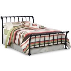 Metal bed with welded grills and sleigh silhouette.   Product: Bed Construction Material: Metal frame