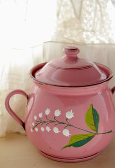 Pink enamel ware with lily of the valley.