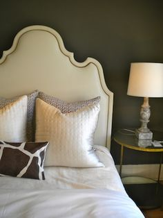 elementsofstyleblog.com - love the simplicity of the headboard and bedding.