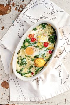 Baked Eggs with Herbs and Tomatoes