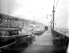 Old Granville Street Bridge being dismantled and new one being built with traffic VPL Accession Number: 39818 Date: 1955 Photographer/Studio: Province Newspaper. www3.vpl.ca/...