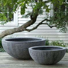 Tall Fiberstone Bowl $198.00 Hand-crafted from a durable blend of fiberglass and stone, this footed bowl adds long-lasting visual interest to container gardens thanks to its frost-resistant properties and light construction.  - Handmade - Fiberglass, stone - Drainage hole included  - Indoor or outdoor use - Imported