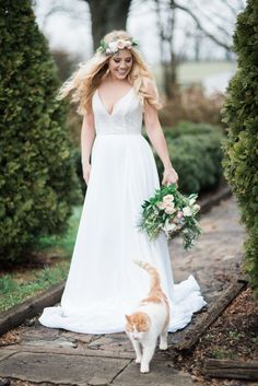 Garden Wedding - Kitty shows up on the scene! Sunkissed Blooms floral design photographed by Lyndsey A Photography at Ashley Inn in Kentucky. Wedding florals with lots of lush greenery and garden-inspired natural textures.