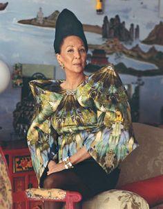 Photo by Richard Avedon  China Machado wears Alexander McQueen's silk satin dress, to order, 212.645.1597. Tony Duquette earrings; Nicholas Varney bracelet.