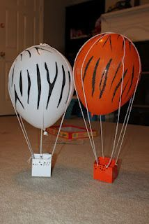 Science experiment - homemade hot air balloons. Helium balloons from the floral department, yarn, paper and tape. They really float!
