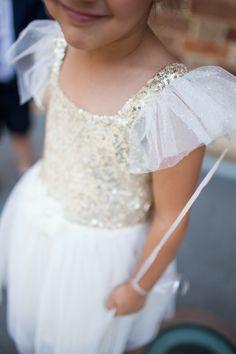 Sparkly flower girl | Photography: Amelia Claire Photography - ameliaclairephoto.com  Read More: http://www.stylemepretty.com/australia-weddings/2015/05/19/elegant-perth-garden-wedding/