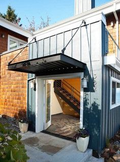 metal roof awning - Tobin High Bluff Waterfront Remodel - modern - exterior - seattle - by Dan Nelson A. Container Home Designs, Shipping Container Design, Shipping Containers, Front Door Awning, Porch Awning, Porch Canopy, Diy Awning, Front Stoop, Metal Door Awning