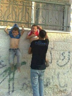 Hamas Hangs Young Children On Fence To Use As Human Shields