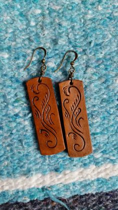 Check out this item in my Etsy shop https://www.etsy.com/listing/506017373/leather-earrings-with-decorative-cuts