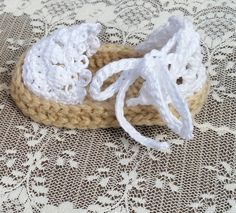 Beautiful handmade crocheted baby girl Espadrilles sandals would make a wonderful addition to any little girls wardrobe. These delicate little sandals are made with 100% super soft acrylic yarn as well as 100% cotton embroidery floss. They are super comfortable and easy for little babies to wear. Each one can be tied gently around the ankle in a neat bow to keep them in place. The shoes are made to order and of course can be made in any color youd like. The shoes in the picture are made in…