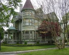 Victorian house with amazing front porchand three story turret.