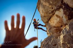 Climbing and helping hand by turansezer