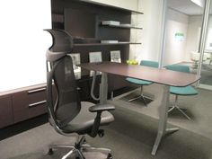 Teknion Journal Office with floating shelves and sliding whiteboard Teknion hiSpace height adjustable table with new leg design Sabrina task chair with Teknion B&B Cosmos chair