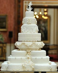 Gorgeous wedding cake! I love how the icing is detailed to look like lace and flowers.