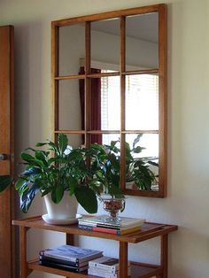 a salvaged window pane into an awesome mirror - excellent idea!// use glass spray to turn panes into mirrors...I love mirrors to brighten up space