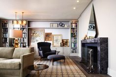 Designed to evoke a classic pre-war Manhattan apartment, the London Terrace penthouse incorporates antiques from both 1stdibs and the Paris flea markets. The living room, for example, features vintage sofas, lamps and chairs combined with custom bookshelves and a fireplace by Janson Goldstein; the rug is by David Hicks