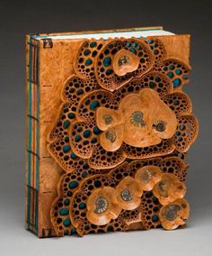 Hand carved book covers (by Mark Doolittle) and hand-made binding (by Kathy Doolittle). The book cover features fossil ammonites from Morocco (150 mya).