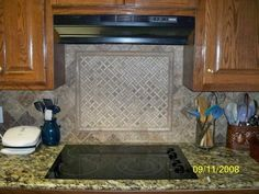 Decorative Wood Hood And Detailed Glass And Ceramic Backsplash As