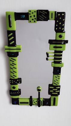 Check out this item in my Etsy shop https://www.etsy.com/listing/494677806/amazon-green-black-glass-mirror-funky