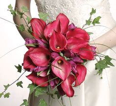 Exquisite hot pink calla lilies. The name Calla lily comes from a Greek word meaning beauty. This exotic arrangement will make for a spontaneous and fun decoration on your special day.