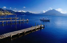 Atitlan Volcanoes, Panajachel, Guatemala  Lake Atitlan boat jetties with the view of Toliman and Atitlan Volcanoes