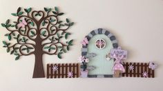 A personal favourite from my Etsy shop https://www.etsy.com/uk/listing/273301354/hand-painted-wooden-fairy-door-with-tree