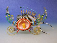 """A see-it-across-the-room brooch called """"Teeth Fish"""" by artists Cynthia & Erh-Ping using  unique color clay inlay and high-fired porcelain techniques. really fun and unique stuff... see more ...  http://www.jewelry10.com/Merchant2/#"""