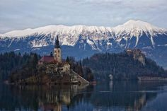 This picturesque body of water can be found in the Julian Alps in northwestern Slovenia. The lake surrounds Bled Island, which houses several buildings, including a church that hosts a good number of weddings each year. In fact, it's considered good luck for the groom to carry his wife up the 99 steps of the church's tower to ring the bell at the top. During winter, the lake turns a frosty blue and reflects the surrounding snowy mountains on its surface.