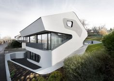The rounded forms of this house near Stuttgart by German studio J. Mayer H. conjure up images of a dinosaur's head with big eyes and bared teeth (+ slideshow).