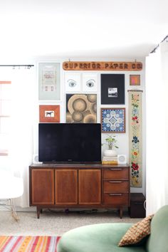 Vintage TV unit and gallery wall