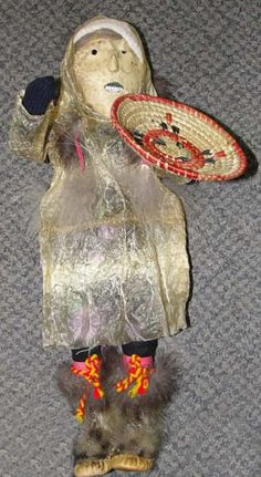 Alaskan Eskimo doll seal gut parka Seal Skin Face, Beach Grass Basket, and Seal Mukluks. 14 in.