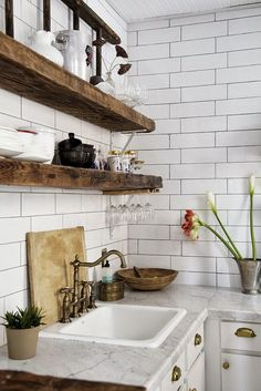 Dana Point vacation rental | white tile walls, marble countertop, white cabinets + wood shelves