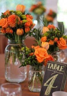 rustic orange fall wedding centerpiece