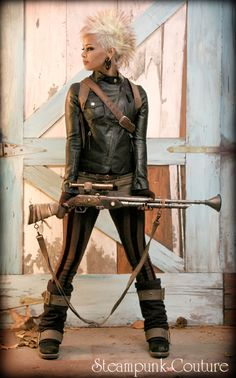 Love her hair, love her gun, love her tights and harness too!