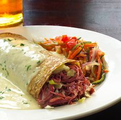 This is what I call elevated Irish cuisine.  This is from Fadó Irish Pub.    Dish: Corn Beef Wrap in Irish Cream Sauce with Sauteed Julianne Vegetables    #EatGoodLiveGREAT #StPatricksDay2013