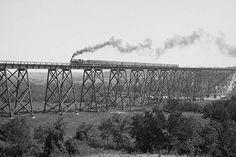 Steam locomotive & Train passes over Valley Trestle Bridge -Chicago & North Western Railway viaduct over Des Moines River, near Boone, Iowa